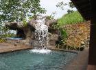 Waterfall into swimming pool